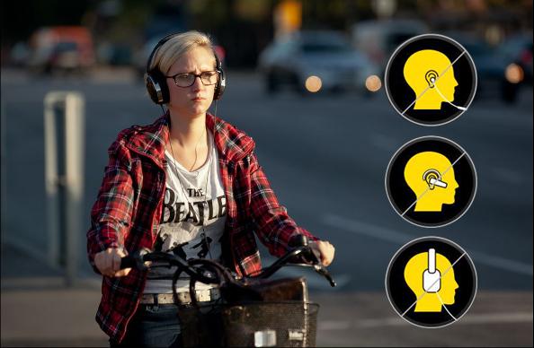 Les casques audio et les écouteurs interdits à vélo