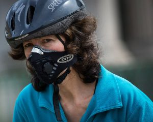 woman-wearing-anti-pollution-mask-rides-bicycle-hyde-park-corner
