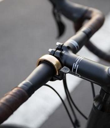 Sonnette vélo Oi Knog couleur dorée